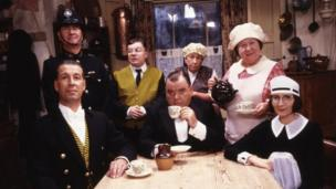 Paul Shane (centre) in You Rang, M'Lord? with co-stars (l-r) Jeffrey Holland, Bill Pertwee, Perry Benson, Barbara New, Brenda Cowling and Su Pollard