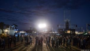 Fans arrive to witness the French group Daft Punk's album launch in Australia's tiny town of Wee Waa