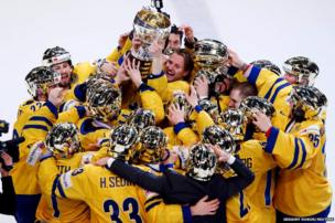 Sweden's players celebrate with the 2013 IIHF Ice Hockey World Championship trophy