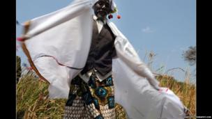 Traditional healer in Tanzania in a three-piece suit