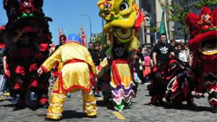 Chinese lion dancers, Indian drummers and Polish troops
