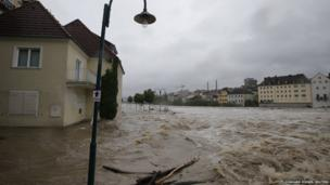 Flooded houses next to river Steyr are pictured during heavy rainfall in the small Austrian city of Steyr June 2, 2013