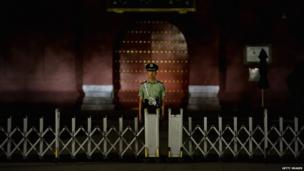 A Chinese paramilitary policeman guards after the customary ceremony of lowering flag at Tiananmen Square on 3 June 2013 in Beijing, China
