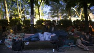 Protestors sleep as morning breaks at the Gezi park in Taksim Square