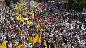 Anti-government protesters march during a demonstration in Ankara
