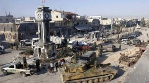 A general view shows soldiers loyal to the Syrian regime with their military tanks in Qusair on 5 June 2013