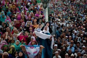 Kashmiri Muslims pray on the occasion of Mehraj-u-Alam, at the Hazratbal Shrine on the outskirts of Srinagar, India