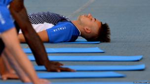 Italy's forward Stephan El Shaarawy stretches