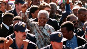 Nelson Mandela at an election rally in 1999