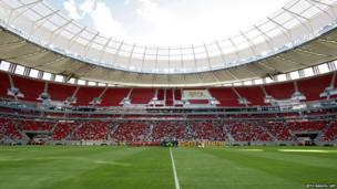 Players stand on the field at the Mane Garrincha National Stadium before the 2013 Brasilia's Championship final football match between Brasilia and Brasiliense in Brasilia, 18 May 2013