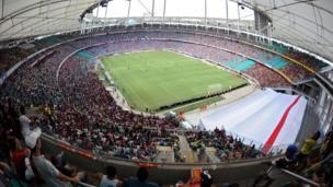 "Brazilians watch a match between Esporte Club Bahia and Esporte Club Vitoria of the Baiano Championship at the ""Arena Fonte Nova"" stadium during its official inauguration in Salvador de Bahia, Brazil on April 7, 2013."