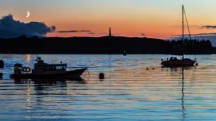 Boats in Oban Bay at sunset
