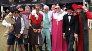 Festival-goers in fancy dress