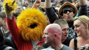 A fan dressed as the Honey Monster before the 3 Doors Down performance at Download festival on Friday