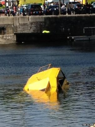Tip of amphibious tourist craft sticking out of the water in Albert Dock, Liverpool, England. Photo: Tim Olsen
