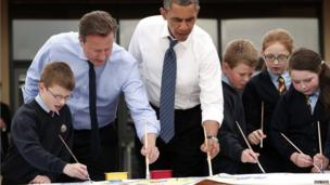 UK Prime Minister David Cameron and President Obama with school children in Enniskillen