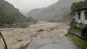 A flooded Badrinath highway road is seen near Joshimath district in northern Indian state of Uttarakhand, India, Monday, June 17, 2013