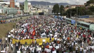 Demonstrators march toward the Mineirao Stadium, where Nigeria was playing Tahiti in the Confederations Cup, during one protest in Belo Horizonte, 17 June 2013