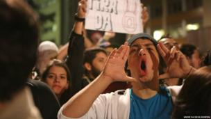 Protesters shout slogans at a protest in Brazil, 17 June 2013