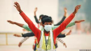 Construction workers wear face masks in Singapore