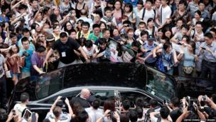 David Beckham fans gather as he visits Tongji University in Shanghai, China