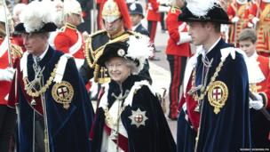 Queen Elizabeth II walks in procession with The Price of Wales and The Duke of Cambridge in the annual Garter Ceremony at Windsor Castle