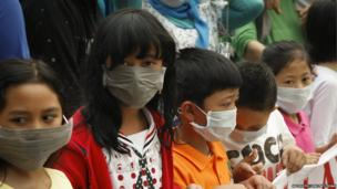 Malaysia Southeast Asia Haze Tourists wear face masks.