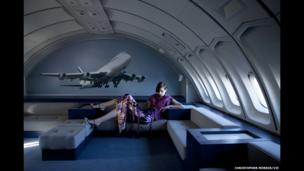 Model Suzy Bird wearing Louis Vuitton at the Musee de L'Air et de l'Espace, Paris Le Bourget Airport