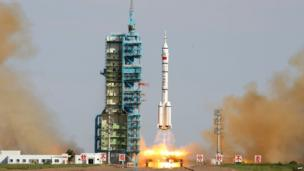 China's Shenzhou-10 rocket blasts off from the Jiuquan space centre in the Gobi Desert on 11 June 2013