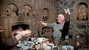 Hospitality is taken very seriously in Georgia. Here, Vazha Nikolaishvili, who runs a small agrotourism business, makes a toast with wine to his guest.