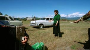 A woman from the Kakhetia region celebrating Alaverdoba, a religious and folk festival.