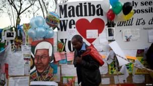 A man prays as he pays his respects outside the Medi-Clinic Heart Hospital, where ailing former South African President Nelson Mandela is being treated, in Pretoria on Thursday 27 June