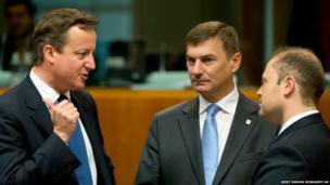 British Prime Minister David Cameron, left, gestures while speaking with Malta's Prime Minister Joseph Muscat, right, and Estonia's Prime Minister Andrus Ansip during a round table meeting at an EU summit in Brussels