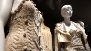 Pictured from left: A 1996 Peter O'Brien evening dress, a 1926 cream evening dress and a 1992 Dolce and Gabbana outfit