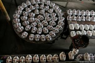 Guy Fawkes masks on the production line