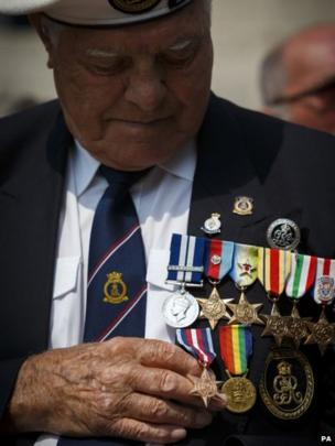 Harold Turtle, 91, from the Isle of Wight looks down at his Arctic Star medal after receiving it for the second time during the Armed Forces Day Parade in Portsmouth.