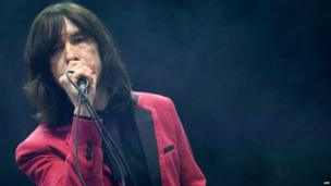 Lead singer of Scottish band Primal Scream Bobby Gillespie performs on the Pyramid Stage.