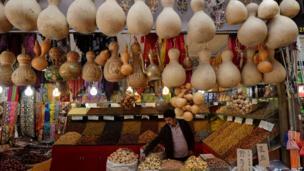 A trader at his stall in the main bazaar in Urumqi, Xinjiang region, 29 June 2013
