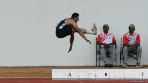 Indian athlete Bharatinder Singh takes part in the long jump
