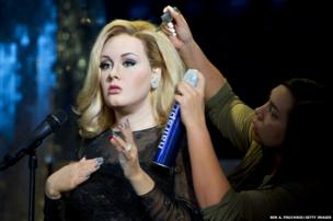 Madame Tussauds in London unveils a waxwork figure of Adele