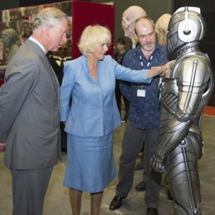 The Duchess of Cornwall and the Prince of Wales with a Cyberman