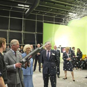 Prince Charles fires a snow gun on the Doctor Who set