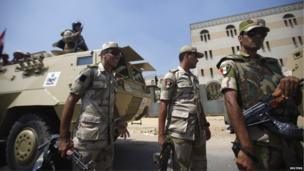 Soldiers stand near the Raba El-Adwyia Mosque in Cairo, 4 July