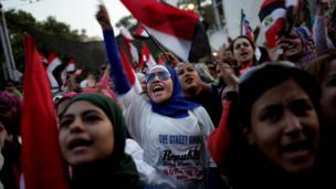 People protest against President Morsi's rule outside the Presidential Palace on 30 June 2013.