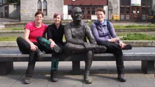 Emma, Deborah and Margaret sitting on a bench