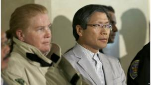 San Francisco Fire Chief Joanne Hayes-White, left, and Korean Consulate of San Francisco Dongman Han listen to speakers at a news conference after Asiana Flight 214 crashed at San Francisco International Airport in San Francisco, 6 July, 2013