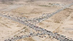 People gather along the side of the highway as the procession for the 19 fallen firefighters of the Granite Mountain Hotshots crew makes its way to Prescott Phoenix