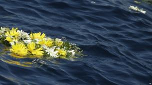 Wreath thrown by Pope Francis into water off Lampedusa