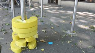 Yellow bike rack works