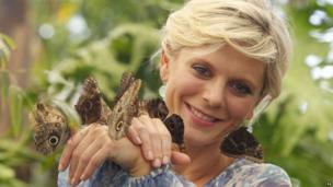 Actress Emilia Fox holds butterflies in the RHS Butterfly Dome with Eden, at the RHS Hampton Court Palace Flower Show